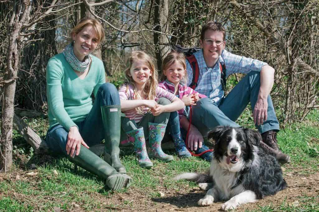 Family with dog in field